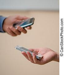 smartphones in the hands of