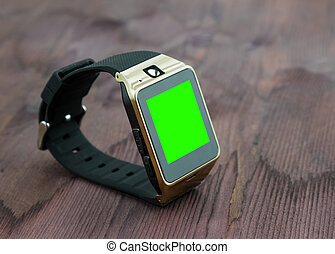 smartwatch isolated on wood background with chroma key green screen