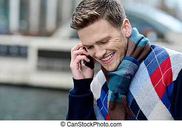 Smartyoung man talking via cell phone