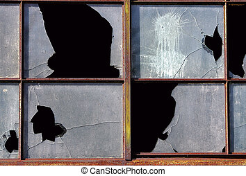 smashed broken windows - broken smashed windows in a...