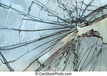 Closeup of smashed glass panel cracked and broken