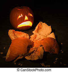 Smashed pumpkin. - Upset jack-o'-lantern looking at smashed...
