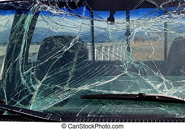 Smashed windshield glass - Broken car windshield glass in a...