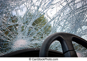 Smashed windshield of a car, seen from the drivers seat.