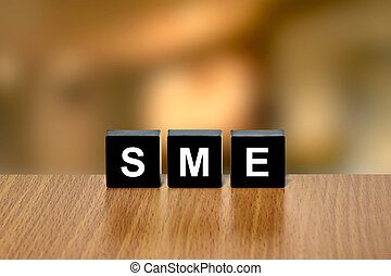 SME or Small and medium-sized enterprises on black block