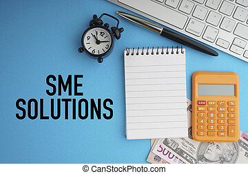 SME SOLUTIONS text with keyboard, fountain pen, alarm clock, banknotes currencies and calculator on blue background