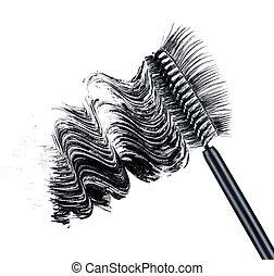 smear of black brush mascara and false eyelashes isolated on white background