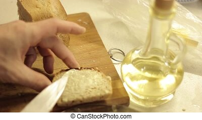 Smeared butter on slice of bread for French toasts.