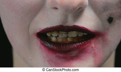 Smeared lipstick and horror grin - Footage of woman with...