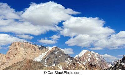 Smearing clouds in mountains. Time Lapse. Pamir, Tajikistan