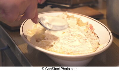Smears mayonnaise in plate with salad - Smears mayonnaise in...