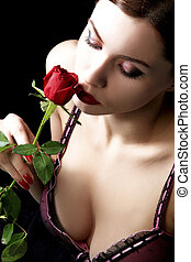 smell 2 - sensual woman with red rose is enjoying