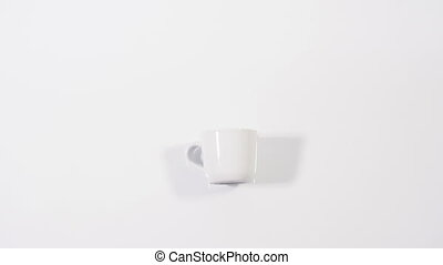 Smell of coffee - White cup of coffee on white background...