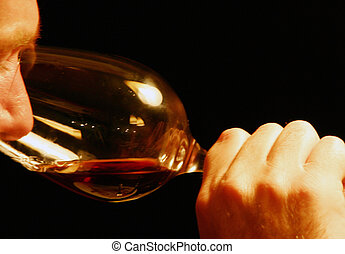 smelling wine - Male smelling red wine in a big wine glass