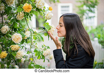 Smelling yellow roses
