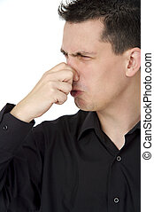 smelly guy - young man holding his nose