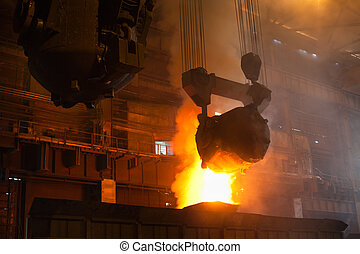 Smelting metal in iron mill - Smelting metal in a...