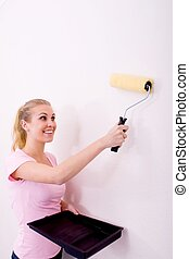 smiing woman painting