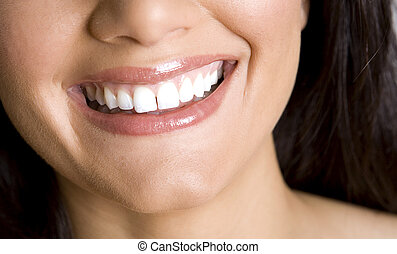 smile and teeth - pretty white teeth and beautiful smile of...