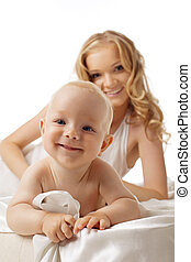 Smile baby and beauty mother on background