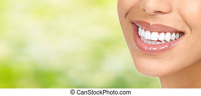 Smile - Beautiful young woman smile close-up. Dental health...