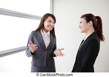 smile business woman team speak to her workmate office, asian