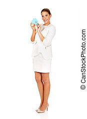 Smile businesswoman holding a paper house