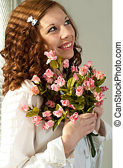 Smile Caucasian female standing with flowers