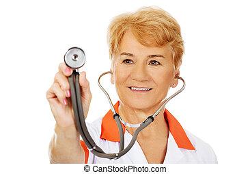 Smile elderly female doctor holding stethoscope