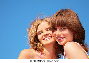 smile faces girls on summer sky