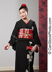 Smile from Asian woman in black japanese kimono - Beautiful ...