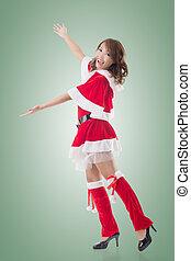Smile happy Asian Christmas girl introduce, isolated full length portrait.