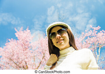 Smile lady with pink cherry flower and blue sky1