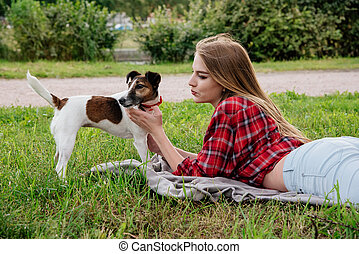 Smile lies on the grass with her dog