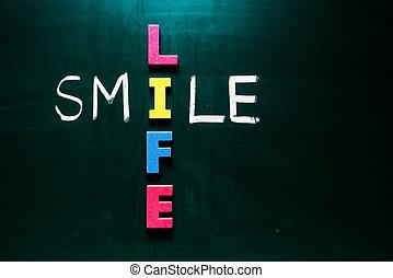 Smile life concept on blackboard