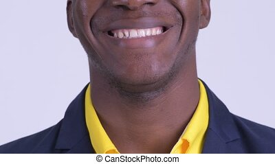 Smile of happy young African businessman wearing suit