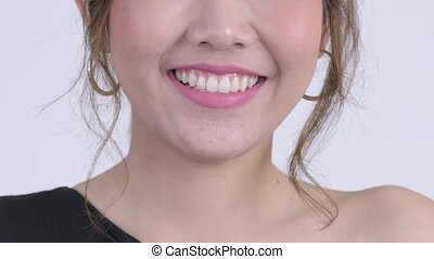 Smile of happy young Asian woman