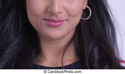 Smile of happy young Persian woman - Studio shot of young ...