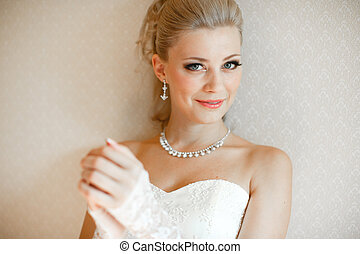 Smile of the charming bride in the wedding dress