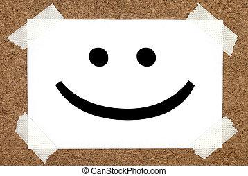 smile on cork board