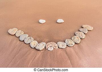 Smile on sand
