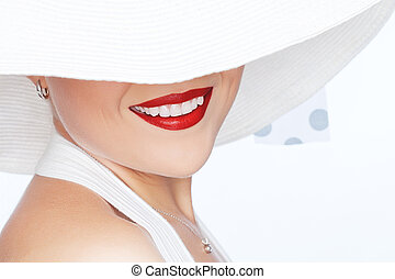 smile - portrait of young beautiful woman in hat on white