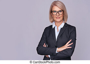 Smile senior business woman with folded hands