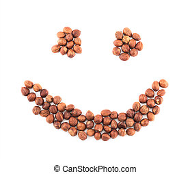 Smile shape made of hazelnuts isolated