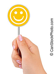 Smile sign in hand