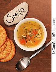 smile with bowl of soup
