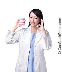 Smile woman dentist doctor teach you brush teeth. Isolated ...