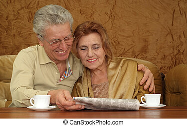 smile woman with a man sitting on a sofa