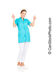 Smile young female doctor or nurse with thumbs up