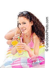girl drink juice on air mattress